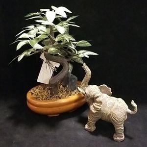 Elephant trunk up, figurine